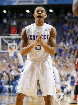Kentucky Wildcats guard Tyler Ulis (3) celebrates during the game against the Alabama Crimson Tide in the first half at Rupp Arena.