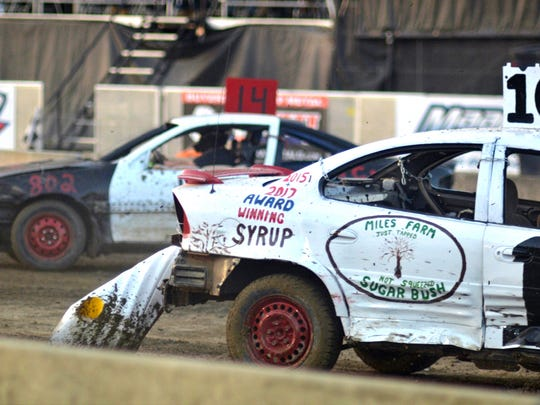 A well-used bumper drags behind a vehicle during the Burnett Scrap Metal Double Figure 8 Race at the Champlain Valley Fair in Essex Junction on August 30, 2017.
