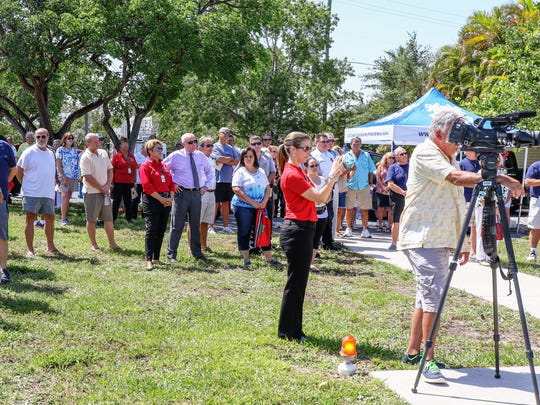 A crowd of locals and guests gather at Greater Naples Fire/Rescue Station 90 on the Isles of Capri on Friday, May 26, to officially dedicate the new Fire/Rescue Boat 90 and to launch it for its mission of providing emergency services on the water.