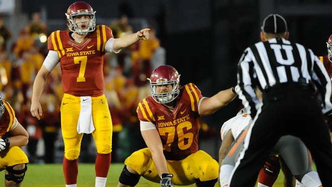 Nov 14, 2015; Ames, IA, USA; Iowa State Cyclones quarterback Joel Lanning (7) and offensive lineman Jamison Lalk (76) point instructions against the Oklahoma State Cowboys at Jack Trice Stadium. Oklahoma State defeated Iowa State 35-31. Mandatory Credit: Steven Branscombe-USA TODAY Sports