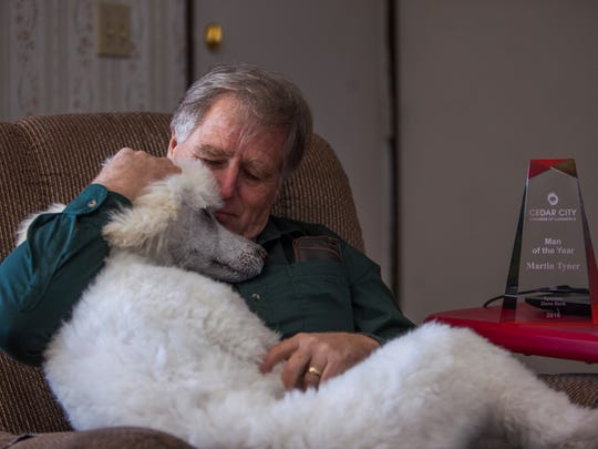 Martin Tyner, CEO and Founder of the Southwest Wildlife Foundation of Utah, sits with his dog, Cody, at his home, Tuesday, Feb. 2, 2016.