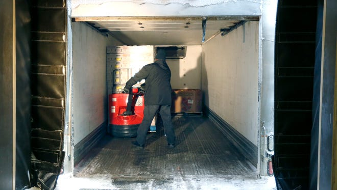 Warehouse manager Perry Jones loads a truck at Foodlink in Rochester.
