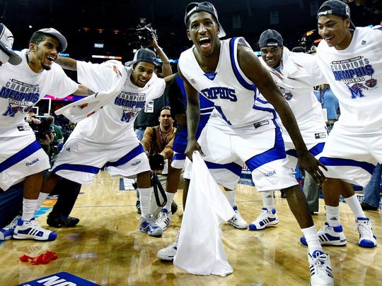 March 15, 2008 - Memphis' Willie Kemp, middle, leads his teammates in a celebratory cheer after defeating Tulsa 77-51 for the Tiger's third straight CUSA tournament title.