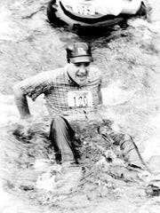 Then-U.S. Rep. Bill Hendon participates in an inner tube race down the Cullasaja River in Macon County in 1982. Hendon died earlier this month.