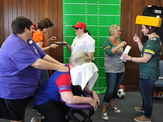 Staff at the North Texas Rehab Center got into the sports spirit for Texoma Gives 2017. From left, licensed massage therapist Charlie Weston gives a massage to Rosie Moser, Jessica Joplin, Paden Lemons, Sheila Moeller and Ashley Sims helped get donors into the spirit of giving.