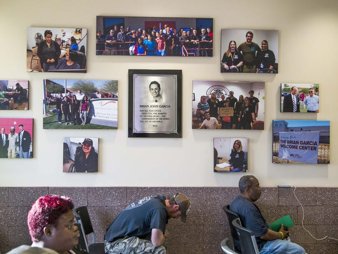 Photos honoring Brian Garcia hang in the lobby of the