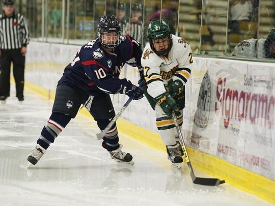 Taylor Willard, right, is one of the key players back for the UVM women's hockey team this winter.