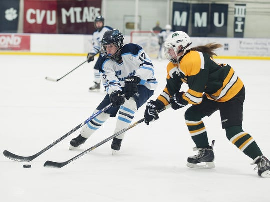 MMU's Lauren Hagerty carries the puck against Burr and Burton during the 2015-16 season.