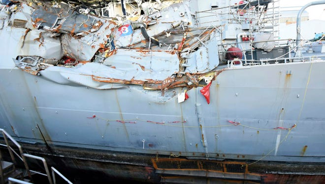 In the photo, provided by the U.S. Navy, the USS Fitzgerald sits in dry dock in Yokosuka, Japan, to continue repairs and assess damage sustained from a June 17 collision with a cargo ship ran in the waters off of Japan.