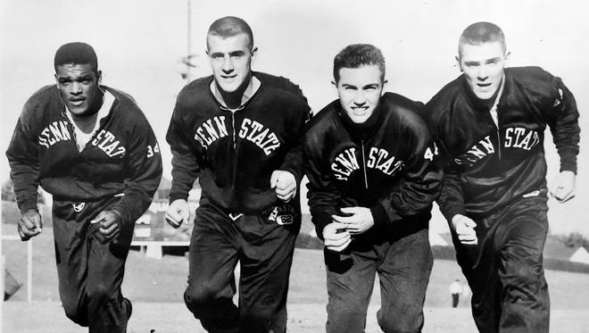 This 1955 photo shows Penn State football players Lenny Moore, Billy Straub, Billy Cane and Bobby Hoffman, as seen Thursday, Feb. 4, 2016, in Hoffman's Lititz home. Hoffman was a defensive back and quarterback for Penn State's 1954 football team, and was one of four football players who also played in the university's 1954 basketball team -- the only Penn State team to reach the NCAA's Final Four.