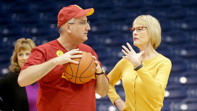 Governor-elect Eric Holcomb and Lt. Governor-elect Suzanne Crouch talk on the Hinkle Fieldhouse basketball court where they hosted an event where supporters and the public got a chance to meet Holcomb and Crouch and shoot baskets on Butler's historic basketball court. Holcomb has made a basket in all 92 Indiana counties.