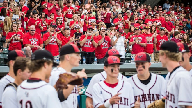 Fans cheer on Wapahani at the start of their state championship game at Victory Field in Indianapolis Friday, June 16, 2017.
