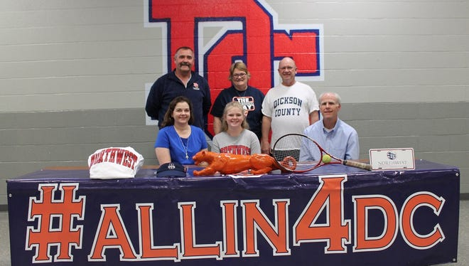 Dickson Co. High senior Emily Blackmarr recently signed with the tennis program at Northwest Mississippi Community College. She's pictured with coaches and family.