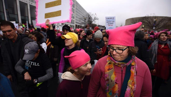 Sara Hjelstrom of Arlington, Virginia, and her daughter, Salome Liptak, 11, wait in Washington for the start of the march.