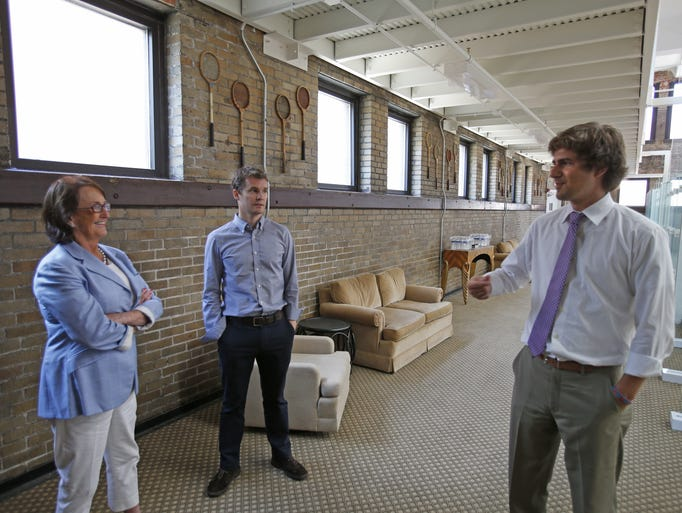 (From left:) Peg Wyant, board chair of the Cincinnati Squash Association, Tim Wyant, executive director of the National Urban Squash + Education Association, and Austin Schiff, executive director of the Cincinnati Squash Association at the Emanuel Community Center in Over-the-Rhine. It's being converted into a combination of office space for tech companies and a squasf facility for low-income children from around the region.<em></em>