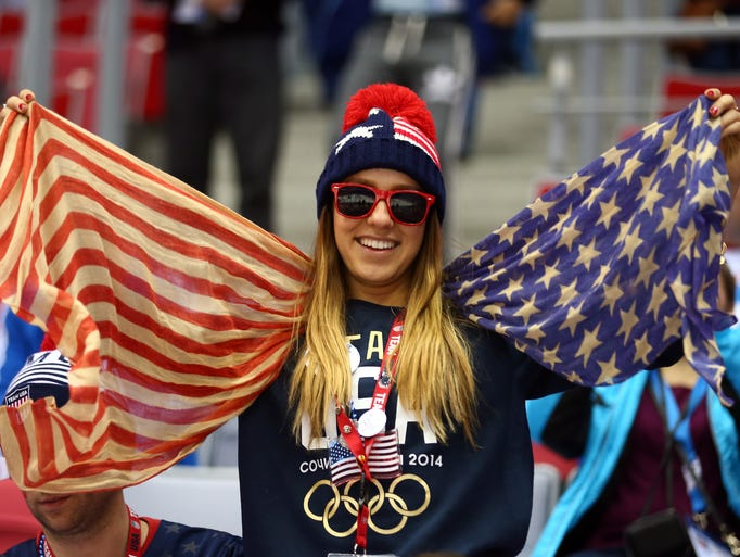 An American fan attends the Men's Ice Hockey Preliminary Round Group A game between Russia and the United States on day eight of the Sochi 2014 Winter Olympics.
