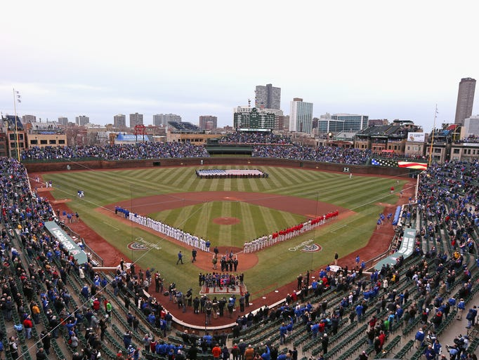 CHICAGO, IL - APRIL 04:  Players for the Chicago Cubs and the Philadelphia Phillies stand during the National Anthem before the home opener at Wrigley Field on April 4, 2014 in Chicago, Illinois.  (Photo by Jonathan Daniel/Getty Images)