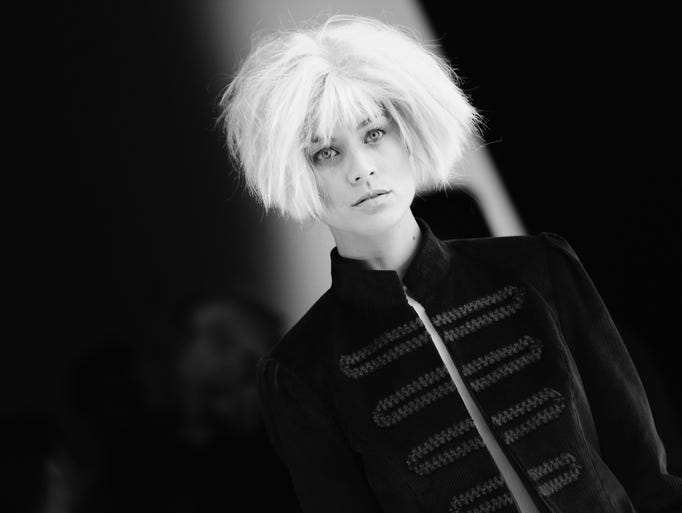 ISTANBUL, TURKEY - MARCH 15:  (EDITORS NOTE: Image converted to black and white) Model backstage at MBFWI presented by American Express Fall/Winter 2014 on March 15, 2014 in Istanbul, Turkey.  (Photo by Vittorio Zunino Celotto/Getty Images for IMG)