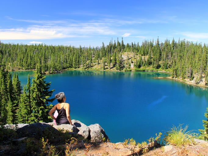 Alea Brager looks out over Gifford Lake in the Ollalie Lake Scenic Area.