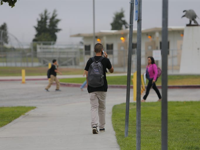A student arrives at Everett Alvarez High School, August 6, 2014, for the first day of School, in Salinas.