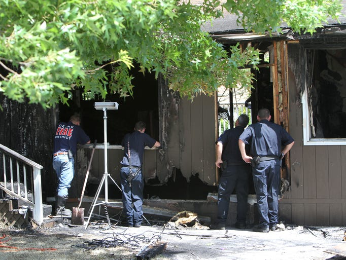 A body was found at the scene of a fire at 1200 block E. McCracken Rd. in Ozark on Tuesday, June 17, 2014.