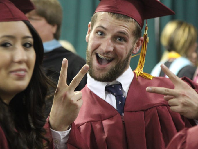 Florida State University Schools Class of 2014 celebrates Friday night at the Civic Center during their commencement ceremony.