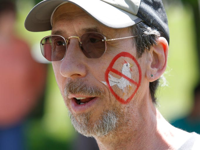 Jeff Gensen of Suffern, joins a protest of a industrial chicken slaughterhouse in the planning works in New Square on June 1, 2014.  The protest was held just across the street of the proposed site in New Hempstead on Rovitz Place.