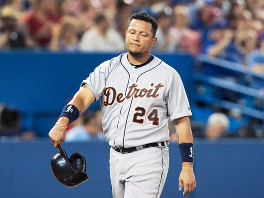 Detroit Tigers' Miguel Cabrera walks back to the dugout after being stranded at third base in the sixth inning of a baseball game against the Toronto Blue Jays in Toronto, Friday July 8, 2016. (Fred Thornhill/The Canadian Press via AP)
