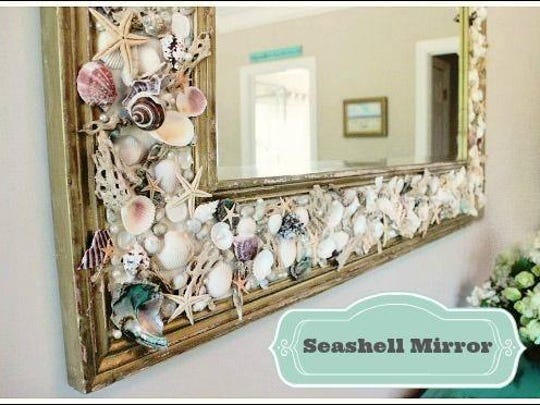 Jennifer Davenport hot glued all sorts of shells, driftwood pieces and starfish around the mirror.