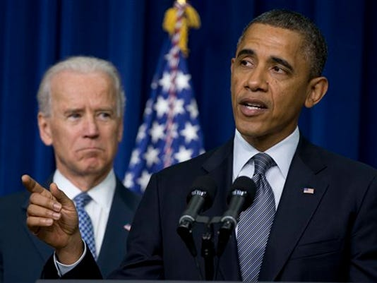 President Barack Obama, accompanied by Vice President Joe Biden, talks about proposals to reduce gun violence, Wednesday, Jan. 16, 2013, in the South Court Auditorium at the White House in Washington. (AP Photo/Carolyn Kaster)