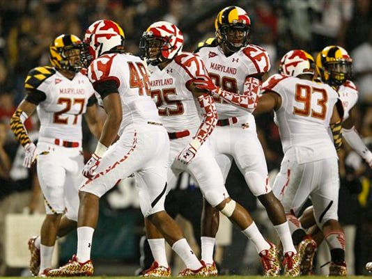 Members of the Maryland football team sport state-flag inspired uniforms on Sept. 5 in College Park, Md.