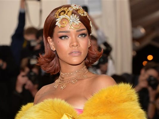 "FILE - In this May 4, 2015 file photo, Rihanna arrives at The Metropolitan Museum of Art's Costume Institute benefit gala celebrating ""China: Through the Looking Glass,"" in New York."