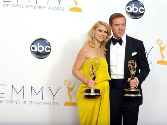 "FILE - This Sept. 23, 2012 photo shows actress Claire Danes, winner of the Emmy for Outstanding Lead Actress In A Drama Series for ""Homeland"" and Actor Damian Lewis, winner Outstanding Lead Actor In A Drama Series for ""Homeland"" posing backstage at the 64th Primetime Emmy Awards at the Nokia Theatre in Los Angeles. The second season of the Emmy award-winning series premieres Sunday at 10p.m. EST on Showtime."