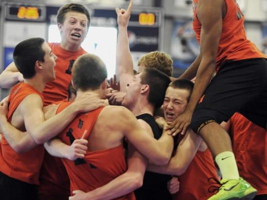 Northeastern celebrates its boys volleyball title.