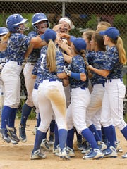 Tess Cites is congratulated by teammates after hitting a grand slam Saturday during Horseheads' 9-8 win over Corning in the Section 4 Class AA title game at the BAGSAI Complex.
