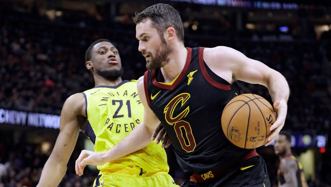 Cleveland Cavaliers' Kevin Love (0) drives to the basket against Indiana Pacers' Thaddeus Young (21) in the first half of a first-round playoff series in an NBA basketball game, Sunday, April 15, 2018, in Cleveland.
