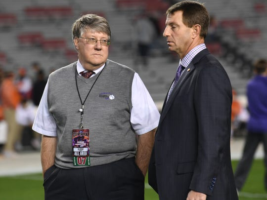 Clemson Sports Information Director Tim Bourret, left, stands near Clemson head coach Dabo Swinney before kickoff in Williams-Brice Stadium in Columbia on Saturday.