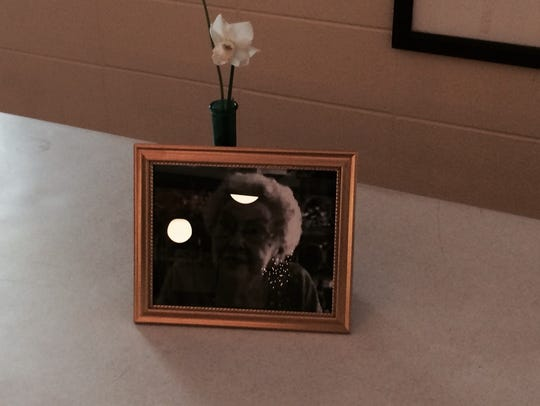 """A photo of Margaretta """"Marge"""" Wolf"""" next to a flower"""