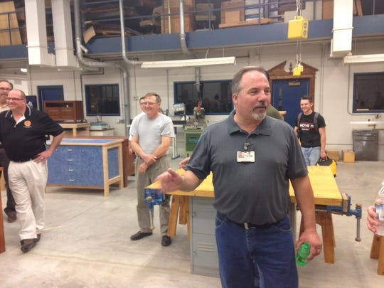 Mark Lorge addresses a crowd of wood maunfacturing professionals during a tour of Fox Valley Technical College, June 4.
