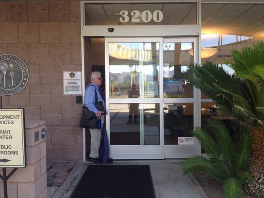 A Palm Springs city employee enters City Hall Wednesday morning to begin his work day. Employees were sent home Tuesday while the FBI conducted an investigation.