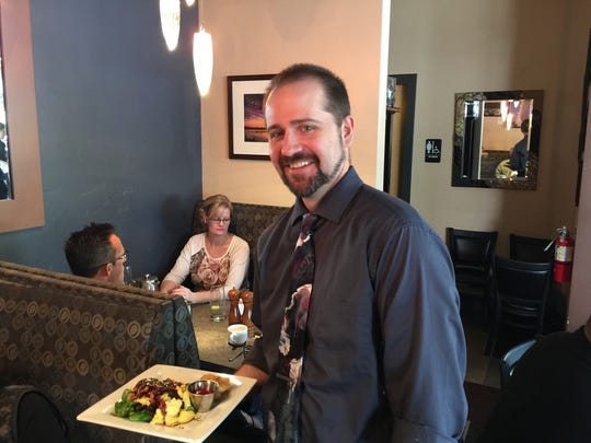 Server Aron Rippey with brunch orders at Moonstone Bistro.