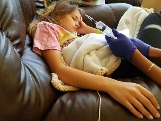 Emilee Cloyd, 13, receiving treatment for Lyme disease in Scottsdale.