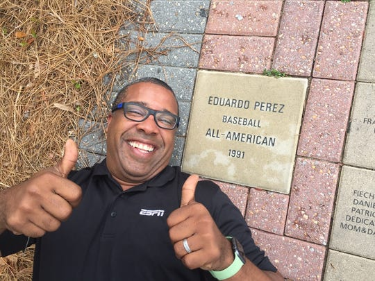 Former Florida State baseball player Eduardo Perez poses in front of his own All American plaque on FSU's campus.