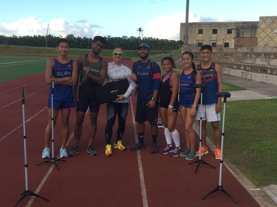 """Dr. Jerone Landstrom from Pacific Hand Surgery Center donated a Laser Timing System to Guam Track and Field Association on Oct. 15 at Guam High School.  """"PHSC is proud to support our Guam Athletes in their training for the upcoming Oceanic and Olympics Games,"""" stated Dr. Landstrom. Pictured from left: Josh Illustre, Athan Arizanga, Dr. Jerone Landstrom, Desmond Mandel III, Shania Bulala, Genina Criss and Zachary Criss."""