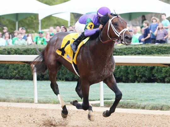 Magnum Moon and jockey Luis Saez win Saturday's Rebel Stakes at Oaklawn Park in Hot Springs, Ark.