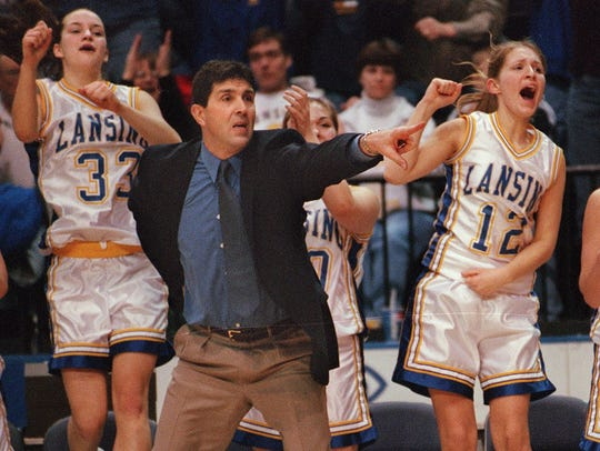 Lansing girls basketball coach Stuart Dean near the