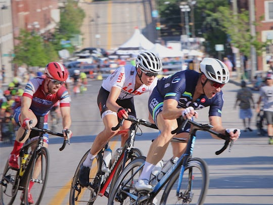 Byrd's Logan McLain (in white) begins the cycling nationals