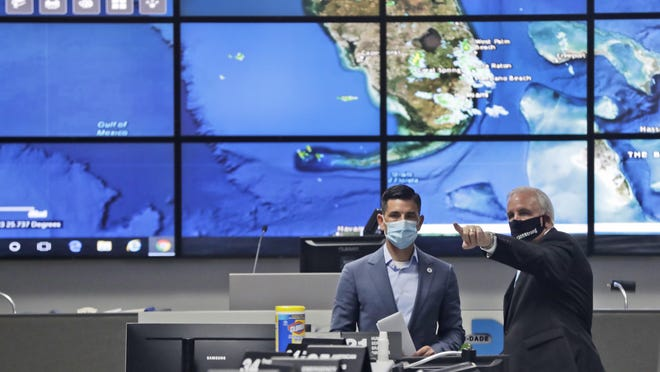 Miami-Dade County Mayor Carlos Gimenez, right, gives a tour to Acting Secretary of Homeland Security, Chad Wolf, of the Miami-Dade Emergency Operations Center, on June 8 in Doral. Wolf, who also toured the National Hurricane Center, spoke during a news conference on the on DHS's operational readiness for the hurricane season.