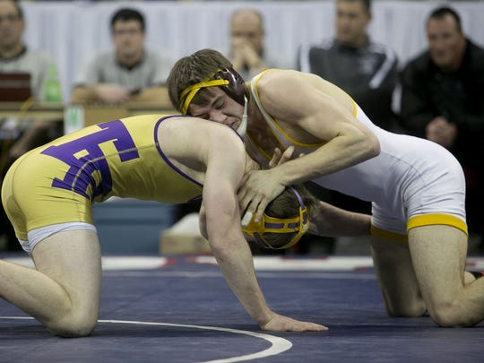 Luxemburg-Casco's Mason Berceau, right, and Two Rivers' Chris Yauch compete in the 138-pound Division 2 final during the WIAA individual wrestling state tournament at the Kohl Center in Madison, Saturday, Feb. 28, 2015.