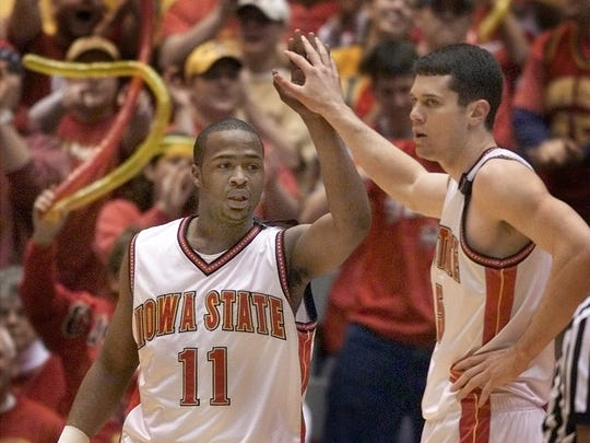 Former Iowa State Jamaal Tinsley standout gets high five from teammate Paul Shirley against Kansas in first half of a game on Feb. 17, 2001 in Ames.